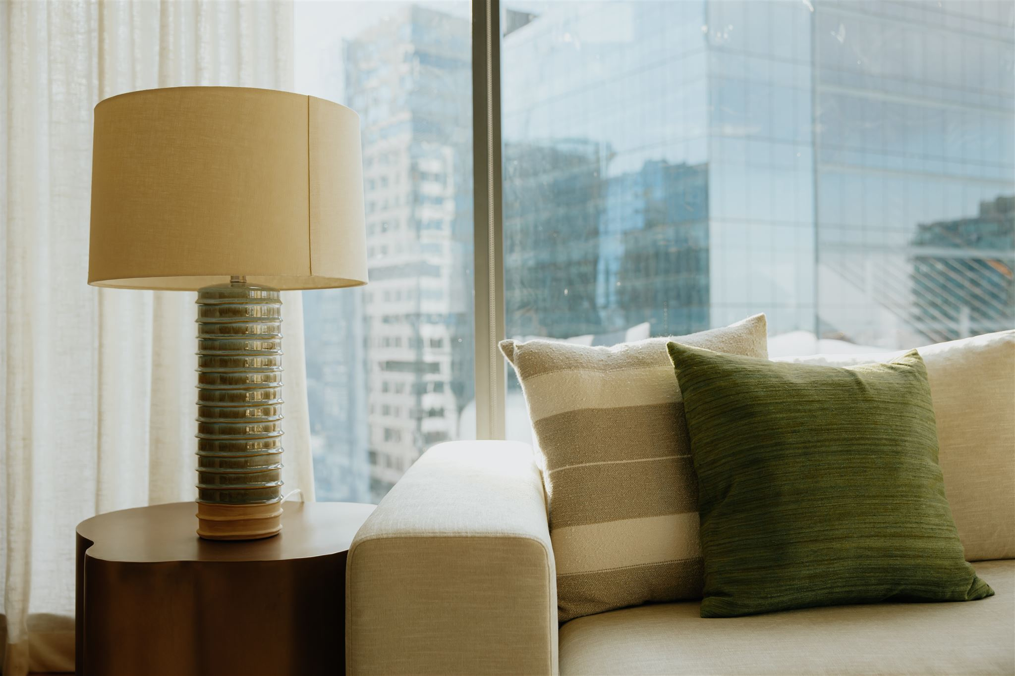 Couch and Lamp in front of Window   4 Things to Tell Your Real Estate Agent When Shopping for a House